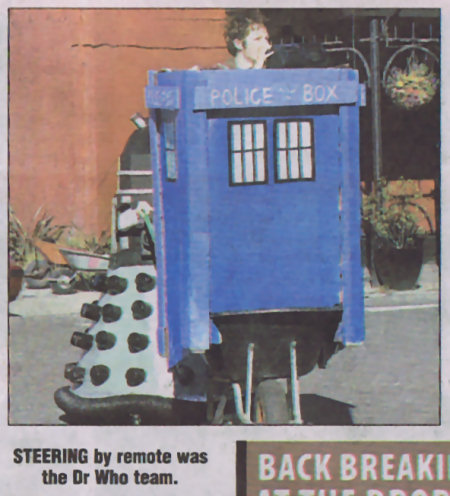 [A Dalek pushing a wheelbarrow]